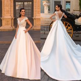 $enCountryForm.capitalKeyWord Canada - Sheer Jewel Neck Lace Satin Long Wedding Dresses Crystal Cap Sleeves Backless Sweep Train Western Summer Bridal Gowns Cheap Custom Made