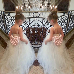 Lovely Evening Gowns Canada - Puffy 2017 Lovely Ball Gown first communion dresses for girls crystal bow kids evening gowns cheap flower girl dresses for weddings