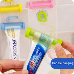 tube squeezers plastic NZ - Wholesale- New Arrival Bathroom Set Accessories Rolling Tube Tooth Paste Squeezer Toothpaste Dispenser Holder Bathroom Products Wall Hanger