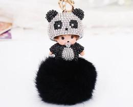 $enCountryForm.capitalKeyWord UK - Cartoon doll panda head keychains key ring cute black hairball keychains Chic girls bag pendant DT12