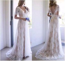 $enCountryForm.capitalKeyWord NZ - Bohemian Beach Lace Wedding Dresses 2018 Spring Garden Champagne V Neck Short Sleeves A Line Cheap Bridal Gowns Custom Made Vintage