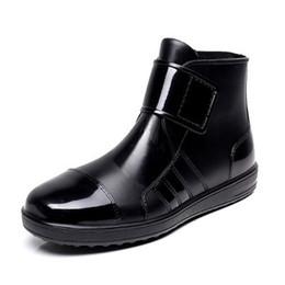 China Wholesale-Pvc waterproof rain boots waterproof flat with shoes woman men rain woman water rubber ankle boots buckle botas 24.5-27cm foot cheap rain water shoe suppliers