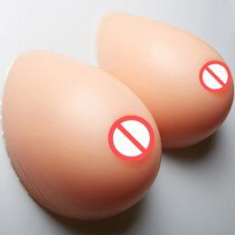 Venta al por mayor de Forma de pecho de silicona de alta calidad Crossdress Forma de busto grande Almohadillas de senos Forma de pecho falso artificial 1 par 800 g