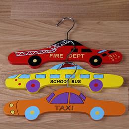 $enCountryForm.capitalKeyWord Australia - Cute Cartoon Wooden Bus Car Taxi Shape Kids Boys Clothes Hanger Baby Children Hanger Garment Holder Racks Wardrobe Organizer ZA3458