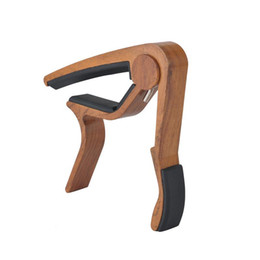 China Free Wood Grain Guitar Capo Perfect for Acoustic Guitar Ukulele Banjo With Aluminum Material - Rose Wood suppliers