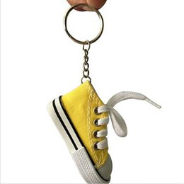 Metal Sneakers Canada - 100PCS Mini Canvas Sneaker Tennis Shoe Key Rings 2.95inch Sports Shoes Key Chain Doll Funny New Year Festive Party Gifts Wholesale