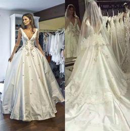 2018 Modern Medieval Wedding Dresses High Quality Satin Backless V Neck Winter Bridal Gowns