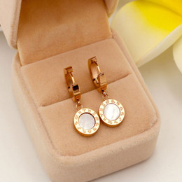 $enCountryForm.capitalKeyWord NZ - Korean ear buckle twelve constellation of black and white shell opening rose gold plated titanium earrings female anti allergy Earrings