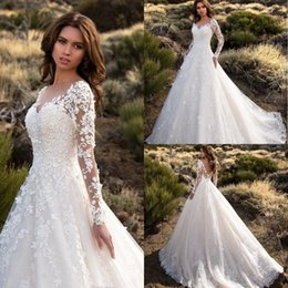 Chinese  2018 Gorgeous Ivory Sheer Long Sleeves Wedding Dresses With Soft Applique Sexy Backless Lace Tulle Bridal Gowns Robe De Mariage manufacturers