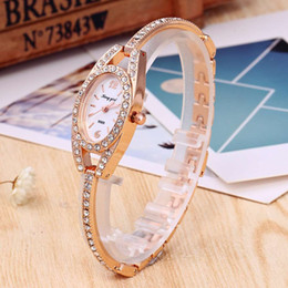 china luxury wholesale jewelry NZ - 2017 New Fashion Hot Luxury Wristatches Artificial Gem gift Unique Rhinestone Diamond Designer Women Quartz watches Cheap China watches