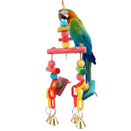 Chinese  Colorful Pet Bird Chewing Toys Parrot Macaw Cage Wooden Blocks Swing Playing Scratcher Hanging Bell Bird Parrot Cage Bite Toy manufacturers