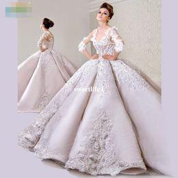 Muslim Wed Gown Cap Canada - Dubai Lxurious V Neck Ball Gown Wedding Dresses 2017 Catherdal Train Appliques Beaded Crystal Half Sleeve Muslim Bridal Gown Custom Made