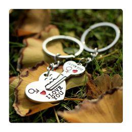 $enCountryForm.capitalKeyWord Canada - TOP Quality Couple Key Chain Cupid Arrow Love Gift Keychains Wedding Supplies Birthday Present Gift I LOVE YOU Heart Keychain Free Shipping