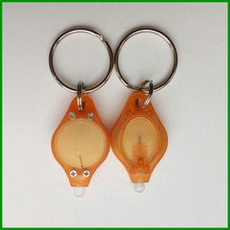 $enCountryForm.capitalKeyWord NZ - Wholesale promotional gifts customized Orange color of body mini led Strong UV Light key chain with metal keyring expoxy sticker of logo