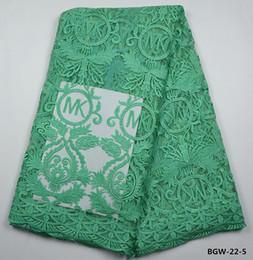 Envío gratis Nueva llegada tela africana del cordón con piedras bordado encaje nigeriano francés cordones telas para boda y fiesta 5 yardas BGW-22