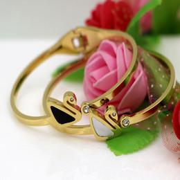 $enCountryForm.capitalKeyWord Canada - The New South Korean jewelry diamond Black Swan white shell titanium bracelet wholesale manufacturers rose gold shells