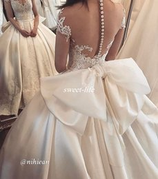 Custom Short Gown Canada - Vintage Ball Gown Ivory Wedding Dresses with Illusion Short Sleeve Sheer Back Button Big Bow Satin 2017 Lace Bridal Wedding Gowns Custom