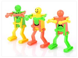 Small Army Toys Canada - Swing dancing robot on the chain clockwork robot baby infant children small toys wholesale flea market