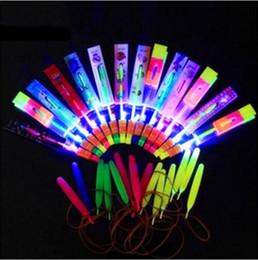 $enCountryForm.capitalKeyWord NZ - 200PCS Free Shipping DHL Helicopter Rotating Flying Toy Amazing LED Light Rocket Party Fun Gift