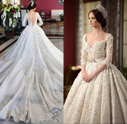 luxury expensive 2016 vintage wedding dresses sexy bling beaded applique embroidry 3 4 long sleeve a line backless cathedral bridal gowns