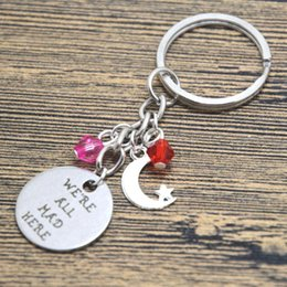 $enCountryForm.capitalKeyWord Canada - 12pcs lot Alice in Wonderland inspired Cheshire Cat keyring We're all mad here Fairytale Jewelry