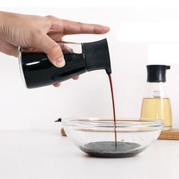 Wholesale green sauce for sale – custom Dripless Glass Soy Sauce Dispenser Pot Controllable Leakproof Olive Oil Vinegar Cruet Bottle with Orange Green White Black Cap