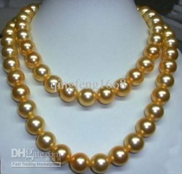 Chinese  35 inch AAA 10-11mm South Sea Golden Pearl Necklace 14K Gold clasp manufacturers