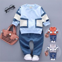 $enCountryForm.capitalKeyWord Canada - Boys two sets of sportswear Spring section of the newly installed long sleeved pants suit tide fan spell Abstract pure color kid257