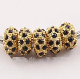 Großhandel 11MM schwarze Rhinestone-Kristallkorne, Rondelle lose Distanzscheiben, goldene große Kristallloch-Korne passten Charme-Armbänder