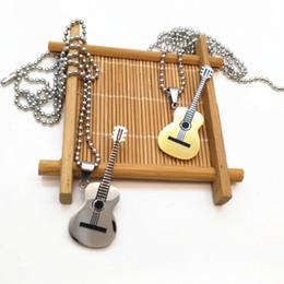 e897cc5bf253 Collar colgante de la guitarra para mujeres regalo de la joyería musical  Nuevo collar de la música de acero moda hombres