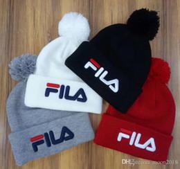 TOP качество Unisex Beanies мужчины осень зима случайный бренд FILA вязаный Hat письмо вышивка дамы pom-pom gorros женские колпаки Гитарный ремень
