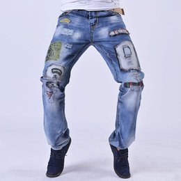 034010ca0a5 Men s fashion clothing style hole patch embroidery jeans 2018 new  men fashion straight denim trousers cotton blue Jeans