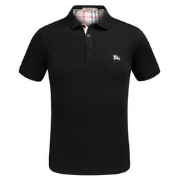 Venta al por mayor de Camisa polo de verano de moda Los hombres casuales 3 patrones de bordado Ropa de hombre solapa Polos manga corta estilo coreanoT camisa M-3Xl