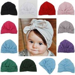 wholesale winter silks NZ - Baby Winter Cap with Bow Wrinkle Cute India Fashion El Sombrero Warm Milk Silk Hat 10 colors