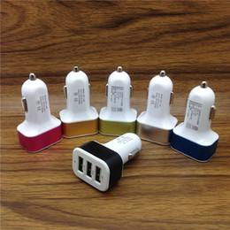 Venta al por mayor de Adaptador universal de cargador de coche triple USB Conector USB 3 puertos Cargadores de coche para iPhone Samsung Ipad DHL gratis