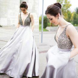 Sheer Black Shirt Pockets NZ - Silver Grey Plugging Prom Dresses Top Beaded Crystal Puffy Elegant Evening Formal Dresses With Pocket Plus Size Red Carpet celebrity dresses