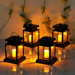 6 colgantes Paquete de luces solares al aire libre solar solar de la linterna de jardín Iluminación para Patio Patio paisaje blanco caliente de la vela del parpadeo del sensor Auto On Off en venta