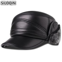 4bbbd428038 SILOQIN Men s Genuine Leather Hat Winter Plus Velvet Thick Warm Baseball Cap  With Earmuffs Sheepskin Leather Hats For Men New