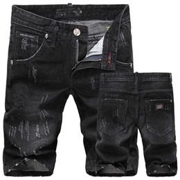 Ingrosso All'ingrosso-SKULL Denim Shorts degli uomini di estate di marca strappato fori casual jeans shorts per gli uomini 28-36 spedizione gratuita FS5181