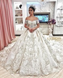 line beaded bodice wedding dresses 2019 - Dubai Arabic Luxury Sparkly 2018 Ivory Wedding Dresses Sexy Bling Beaded Lace Applique Illusion Long Sleeves A Line Chap