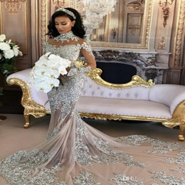 Chinese  Sparkly Sexy Wedding Dress 2020 Sheer Bling Beaded Lace Applique High Neck Illusion Long Sleeve Champagne Mermaid Chapel Bridal Gowns manufacturers