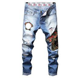 Chinese  New True Men Robin Rock Revival Jeans designer boot cut Straight Pants light blue color robin Jeans For Men Embroidered Grimace Men's Jeans manufacturers