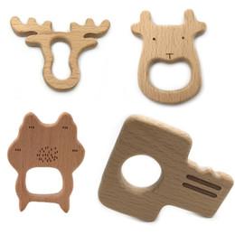 Mordedor de madeira Anéis De Madeira Natural Dentição Brinquedos para Infante, Mordedor De madeira Animais para a Criança, Bebê Soothing Pain Relief Brinquedos em Promoção
