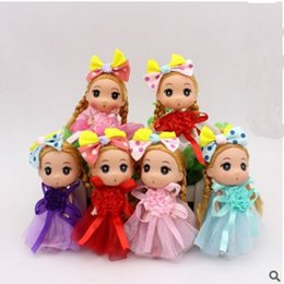 best wedding pendant Australia - 10pcs free shipping Cartoon Doll Toy 12cm Wedding Dress flowers Doll Toys Small Girl Bag Pendant Wedding Party Best Gifts