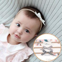 e09e4208e29 Newborn Baby Headbands floral bows 3pcs set Elastic Headband Kids Cute  Hairbands for Girls Nylon Bow Headwear Headdress KHA596