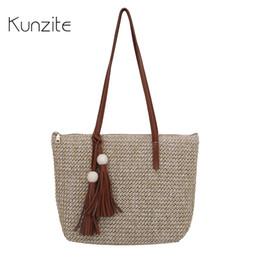 7084a02ef6 KUNZITE Brand Luxury Handmade Straw Handbags For Women Summer Beach Casual  Rattan Bags Designer Knitting Tote Tassel Bag Bolsas