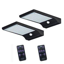 Venta al por mayor de Energía solar LED Luz Control remoto 7 colores Ajustable 48led impermeable Super brillante LED solar luz del jardín