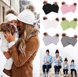 Skull ball capS online shopping - Family Matching cap Winter Warm Striped Cap Fur Pompom Ball Beanies Cap Mom Baby Boys Girls Family Matching Hats KKA6010