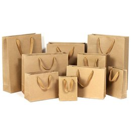 Chinese  10 sizes paper gift bag brown reticule kraft paper bag with handles stock and customized wholesale manufacturers