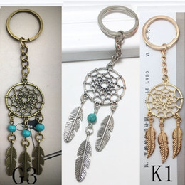 Discount brass feathers charms - Hot Antique Silver Brass Gold key chains Dream Catcher Feather Bead Charm Dreamcatcher Keyring Keychain Car Bag Decorati